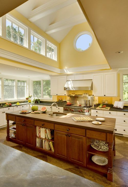 Yellow kitchen with pops of green and I'd add pops of blue.  Love the light coming in from the ceiling cut out as well.