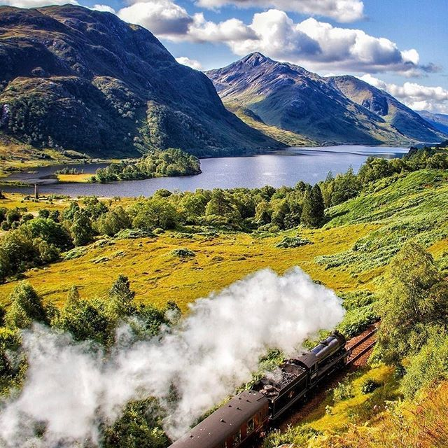 All aboard! What a fantastic shot of the Jacobite Steam Train as it leaves the Glenfinnan Viaduct in Scotland. Sometimes half the fun of a trip is getting there. Thanks for sharing this view with us @thegoodly. #OMGB #Scotland #Glenfinnan