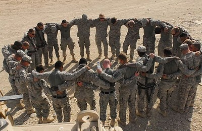 When you get sent out to the field,being deployed, as a soldier it is important to find activities to keep you strong. Not only physically and mentally, but spiritually as well. Here in this picture you can see each soldier praying for one another. This is a very good way to keep strong.