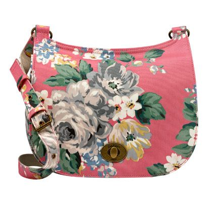 Norfolk Rose Matt Coated Turnlock Saddle Bag | The classic turnlock saddle bag shape has had an update. Our Norfolk Rose print comes coated and wipeable, and there's a flap closure with a popper for added security. The internal zip pocket is sized for your essentials | Cath Kidston |