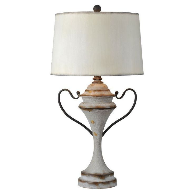 Embodying the traditional trophy look, this versatile table lamp sets the standard for home décor with its distressed wood look and iron-like handles.