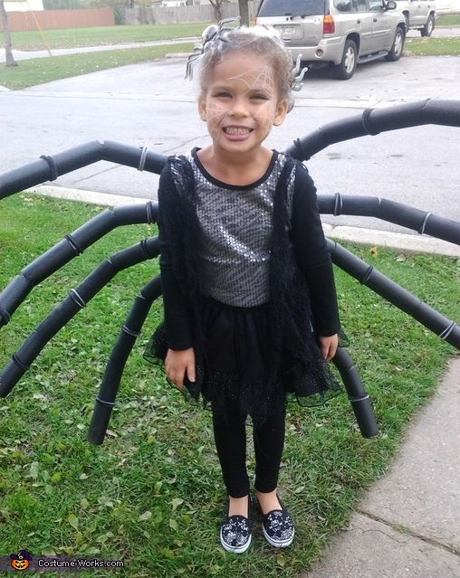 Jamie: Ava is wearing some black tights with black tutu, black and sequins shirt. Some black lacey material for a web like jacket. The legs are made out of pipe insulation...