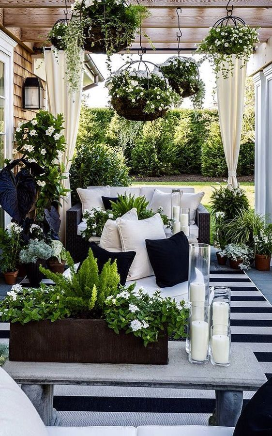 The exterior REALLY matters when selling your home;. Stage your patio with patio with a beautiful covered bohemian gazebo and botanical plants. A black and white stripe outdoor rug can actually hide imperfections in a wooden porch and boost the value of your home!