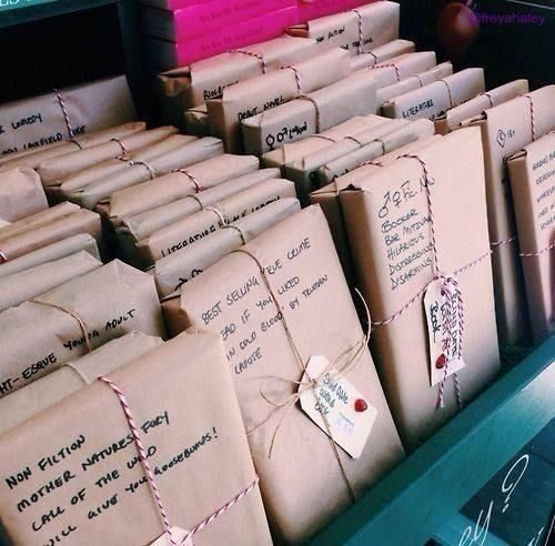 ღღ A book store where books are wrapped in paper with short descriptions so no one will 'judge a book by its cover'.