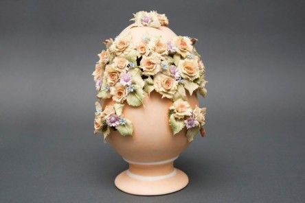 Wonderful Easter Egg Faberge made of Capodimonte porcelain finely decorated with a central opening studded with roses, blue flowers and purple leaves and completely handmade by the artist. www.apoggi.com      Dimensions cm. 25x15