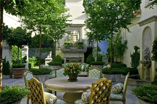 French Courtyard Outdoor Spaces. Heather, potted trees, topiary, symmetry