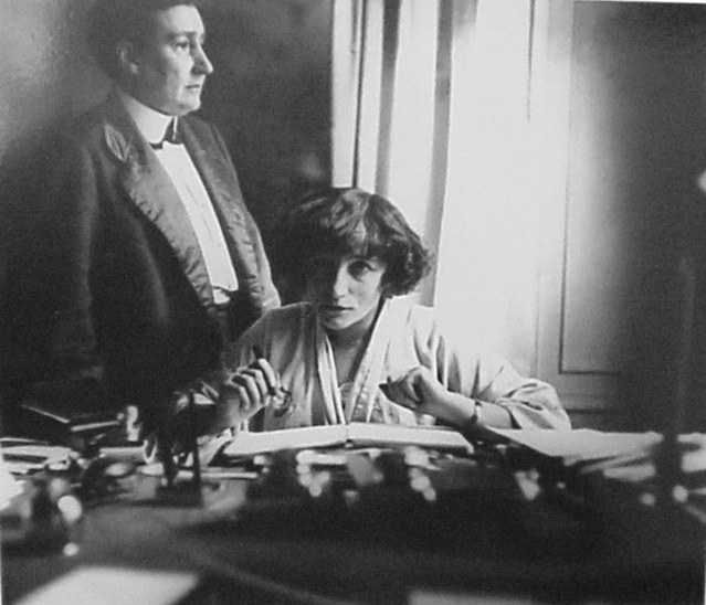 Sidonie-Gabrielle Colette reading in her study