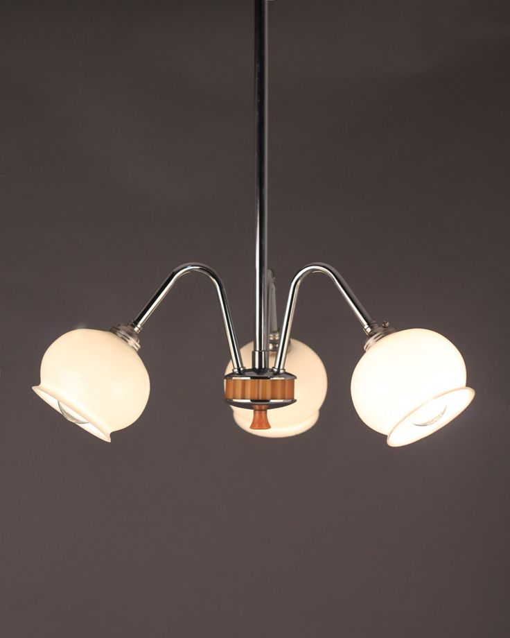 3 branch art deco chandelier with original globe shades with bakelite detailing from fritz fryer