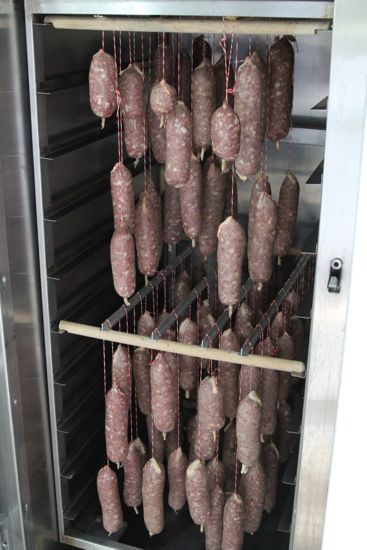 What a proper curing chamber looks like. Also note how red the meat is ...