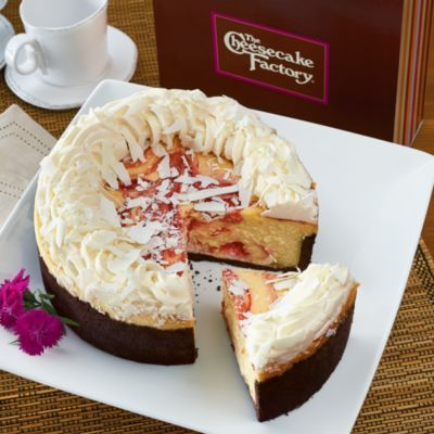 Much like us, The Cheesecake Factory® has been making high quality treats for many, many years. This White Chocolate Raspberry Truffle® Cheesecake is just one of their cheesecakes that we offer as The Cheesecake Factory®'s exclusive online vendor. A rich creamy filling swirled with imported seedless raspberry and set in a chocolate crust, this cake is topped with white chocolate shavings. It blends a fruity zest with lush, buttery elegance and is a great, tasty way to follow up dinner.