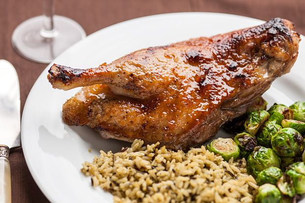 The whole ducks in this recipe are halved, seared, and roasted with an easy glaze of orange marmalade, orange juice, and soy sauce.