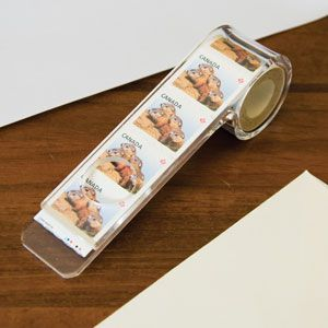 """Stamp Dispenser - Keeps stamps at the ready, and prevents unravelling! Holds a roll of 100 standard size stamps. Acrylic. Stamps not included. (4-1/4""""L x 1""""W x 1-1/4""""H) (Product Number AP1684) $7.98 CAD"""
