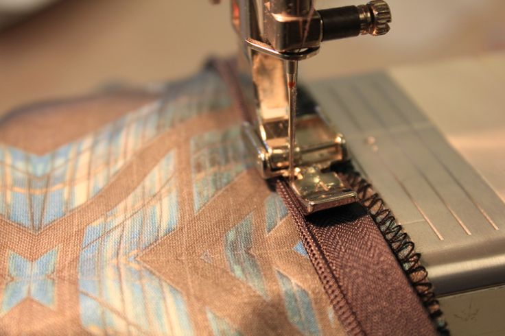 sewing zip into centre back seam using a zipper-foot.