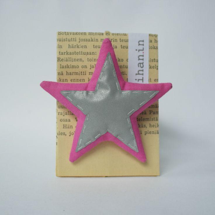 Heijastava tähti, rintaneula