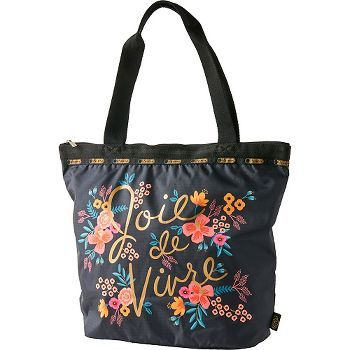 Rifle Paper Co. and LeSportsac have teamed up for this gorgeous carryall. This Rifle tote features their Joy print (in French: Joie de Vivre) in a chic gold on top of the Anna Bond's signature florals