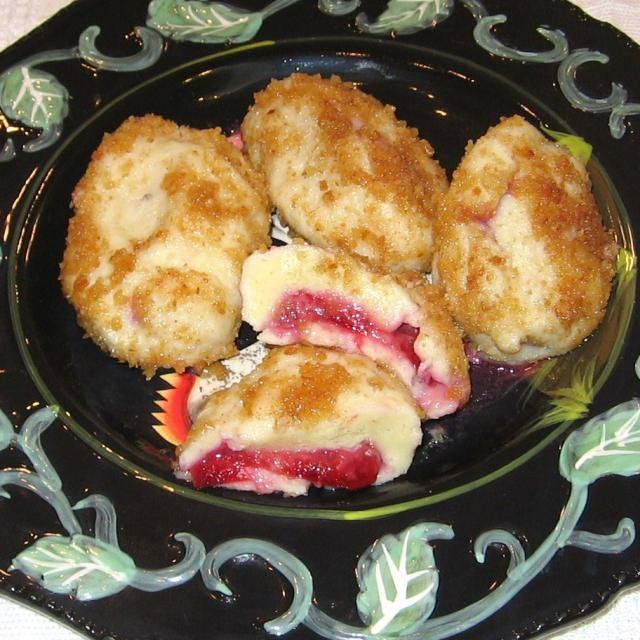 Croatian plum dumplings, known as knedle s sljivama, are made with a mashed potato dough and are coated with buttered bread crumbs and sugar.