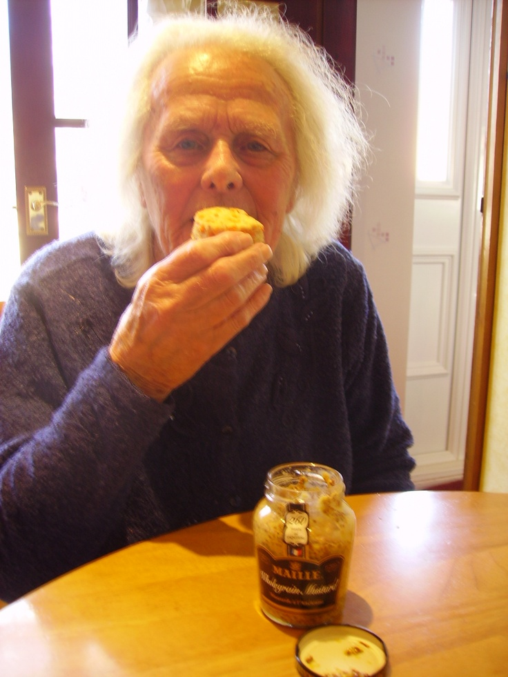 My mum Daphne eating a Cheese and Mustard Scone that I made with my usual Cheese Scone recipe with the addition of a heaped dessert spoon of Maille Wholegrain Mustard! Added a new piquancy to the scones!
