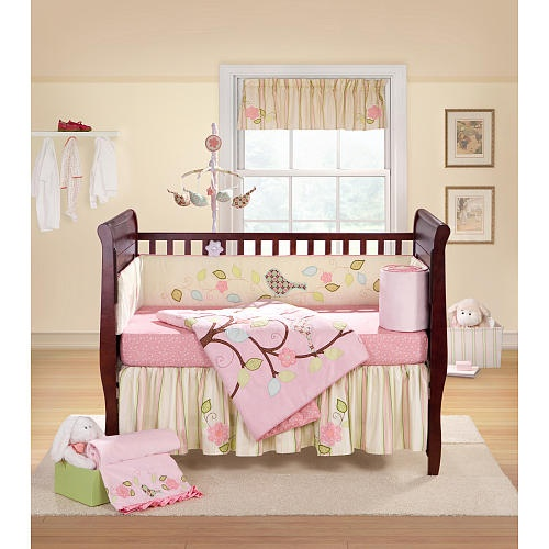 Sophisticated yet soft, the Love Bird baby bedding set by Lucky Duck Studios will enchant all little girls.  Embroidered birds, leaves and flowers embellish the lovely pink and yellow tones of this delightful crib set, which includes comforter, crib sheet, and dust ruffle.