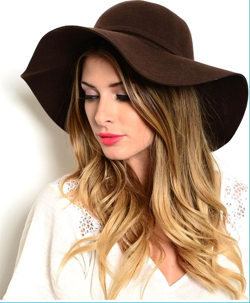 "Boho chic at its best, this floppy wide brim hat features a removable band and 3.75"" brim. Retro and ready to wear to summer festivals or cozied up in the winter. 22.25"" Circumference 100% Wool"