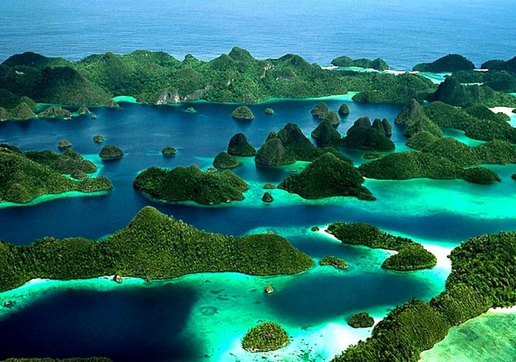 The unbelievably beautiful islands of Raja Ampat in Papua, Indonesia, as seen from above,Raja Ampat (meaning Four Kings) is an archipelago comprising over 1,500 small islands. It encompasses more than 40,000 sq. km. of land and sea, which also contains Cenderawasih Bay, the largest marine national park in Indonesia.