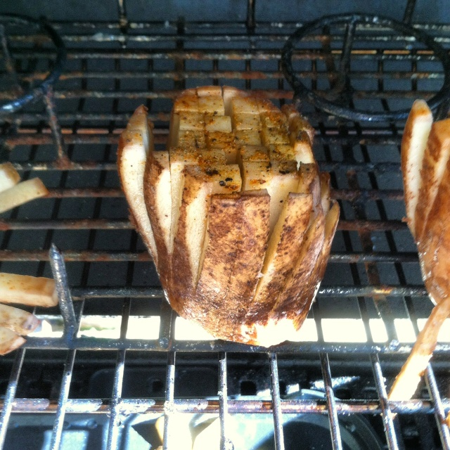 "A fun way to grill a potato. Using a French fry cutter and NOT cut all the way. Leave Atleast an inch and a half of the potato uncut. Rub EVOO and season salt and place upright on top rack of grill. I held mine in place with a ""beer can chicken"" rack. Grill till done and enjoy a healthier French fry!"