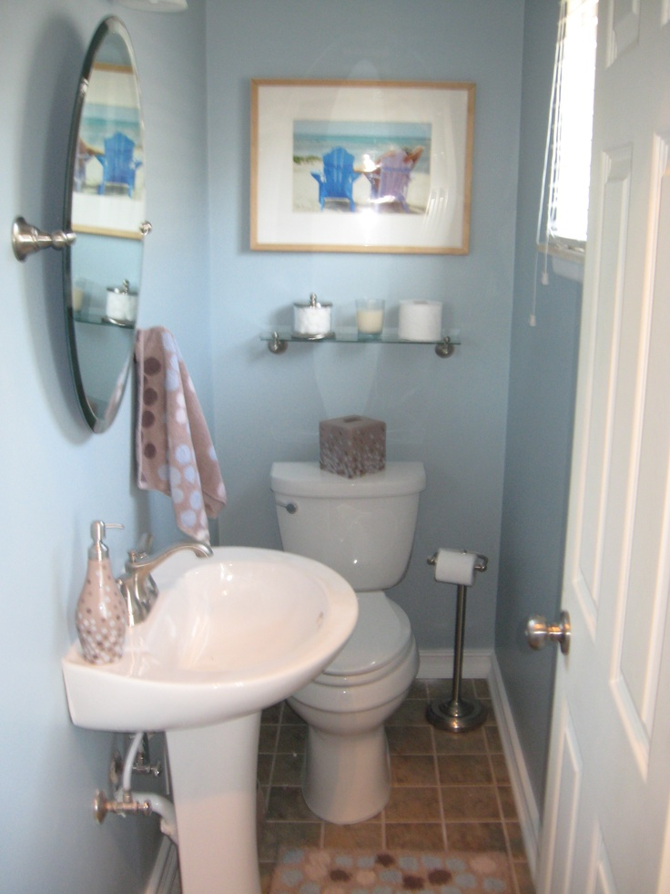 small half bathroom like this combo of pedestal sink and oval mirror