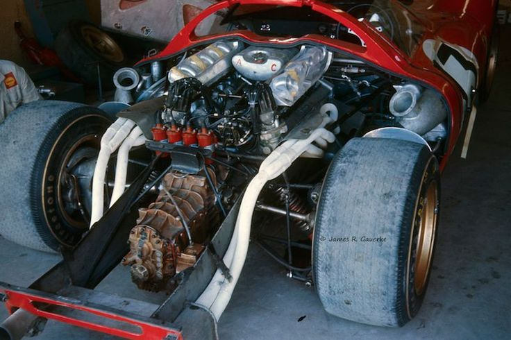 The 4-liter V12 engine of the winning Ferrari 330 P3/4 in the garage before the start of the 1967 Daytona race.  Few in the automotive press gave these cars a chance against the 7-liter Fords.