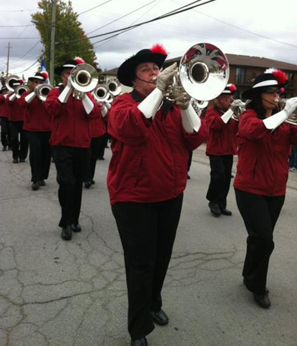 The Preston Scout House Alumni Band's brass section marching during the parade.