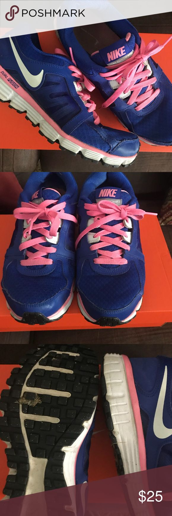 Nike dual fusion sneakers Pre-loved but still in good shape. Shows some sign of wear but still a lot of life left. Awesome color combo royal blue and bubble gum pink adds a pop of fun to black workout wear Nike Shoes Sneakers