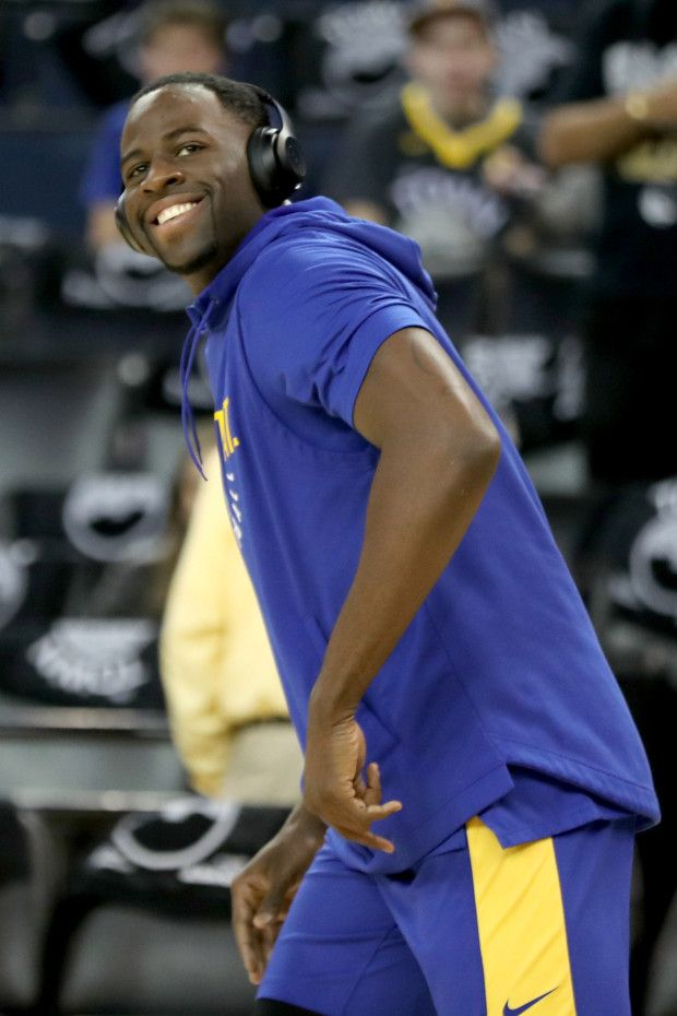 Golden State Warriors' Draymond Green (23) warms up before the start of the game against the Oklahoma City Thunder at Oracle Arena in Oakland, Calif., on Tuesday, Feb. 6, 2018. (Ray Chavez/Bay Area News Group)