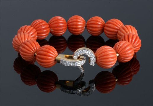 Carved Coral Bead with Diamond closure Bracelet.