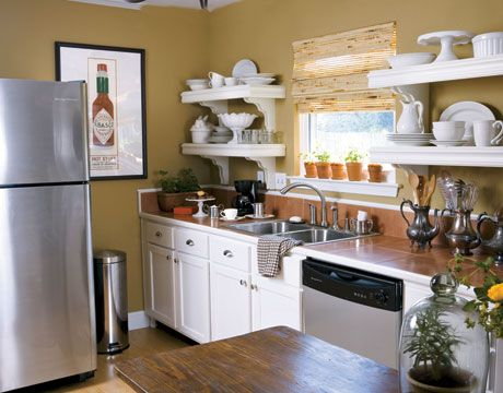 Love this cozy kitchen—especially the Tabasco poster!