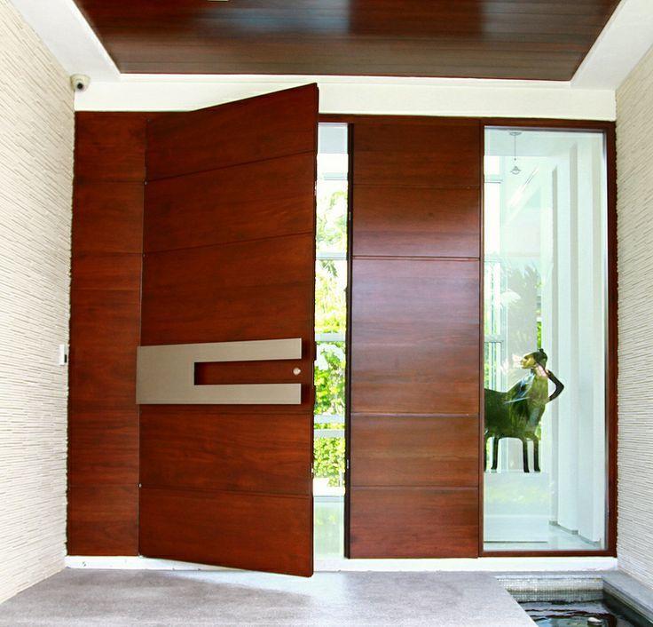 Portone blindato in legno ciliegio e acciaio inox di alta qualità per uno stile minimal moderno