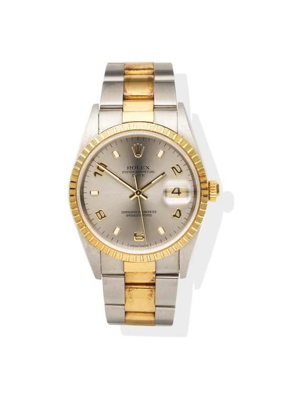 A mid-size, two-tone Date wristwatch, Rolex, circa 2000. Automatic. 34mm. Ref: 15223. Serial number P666865. Silver starburst dial with applied alternating Arabic numerals and luminious indexes, engine-turned bezel, centre sweep seconds, date aperture at 3 o'clock.Case, dial, and movement signed.Original oyster bracelet numbered 78353/457. Case back sticker, box, papers, one extra link and tag. - Price Estimate: $5000 - $8000