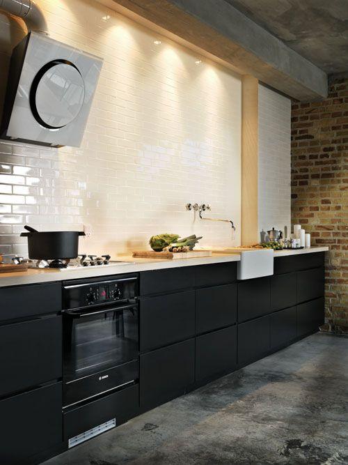 Black cabinets, white subway tile. Photo by Stuart McIntyre