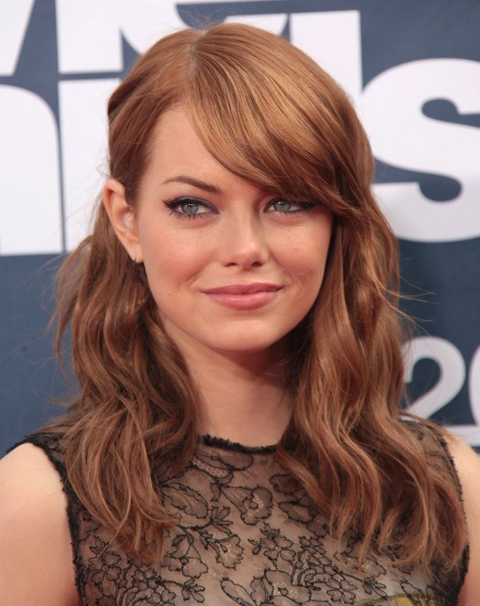 Emma Stone shows off an auburn hair color with blonde highlights. Photo: DFree / Shutterstock.com