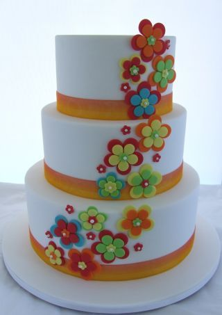 Fruit cake for top tier and marbled mud cake for the other 2 tiers. Colours on this cake matched the couples Wedding invitations.