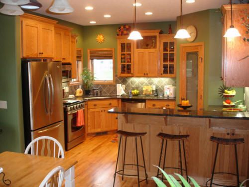 The oak cabinets look great with asparagus walls dark for Dark orange kitchen