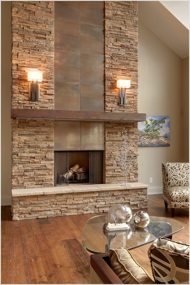 Toronto alta modern chalet beige wall chalet fireplace glass coffee table  metal fireplace rustic wood floor ski chalet slanted ceiling stacked stone  ...