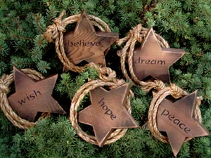 """CHOICE OF ONE STAR/ROPE ORNAMENT: One 5"""" cedar western star ornament with rope stapled to the back and crossed over the front for a mini lariat comes with your choice of words: wish, hope, peace, dream, love or believe. Please let me know which word you want. or I'll send my choice. I've drilled an hole vertically on the top point and added a string hanger, so they will hand straight."""