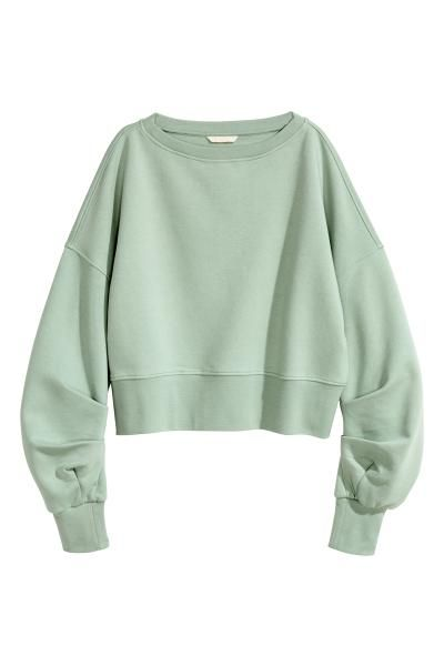 Loose-fitting cropped top in sweatshirt fabric with a wide neckline, dropped shoulders, long, pleated sleeves and wide ribbing at the cuffs and hem. Soft br