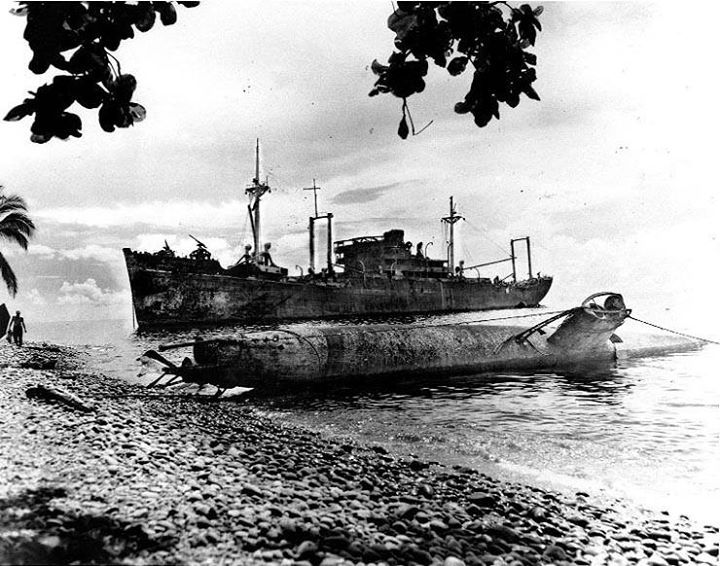 Japanese Type A Ko-hyoteki midget submarine and transport Yamazuki Maru beached on Guadalcanal Solomon Islands 1 May 1944.