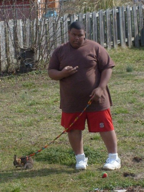 Throwing gang signs while he's walking his bunny. legit.