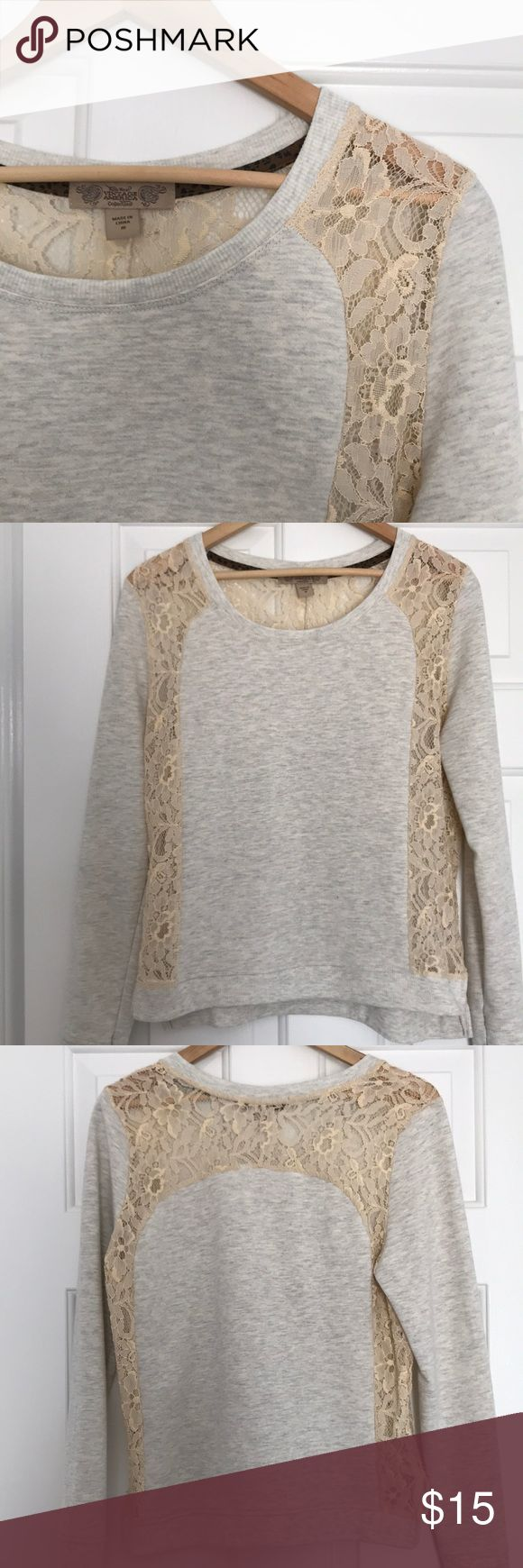 Long Sleeve Sweatshirt with Lace Vintage America Gray terry sweatshirt with cream lace detail. No holes rips stains or fading, worn a handful of times. Super cute and unique! See last photo to get an idea of the material. Looks and feels like a sweatshirt from the outside but it's not fuzzy on the inside. Nine West Tops Sweatshirts & Hoodies