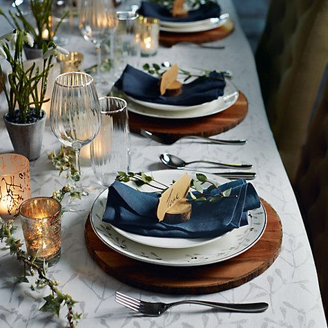 What an elegant Christmas table style this is! The wooden placements work really well, as do the dark blue napkins.