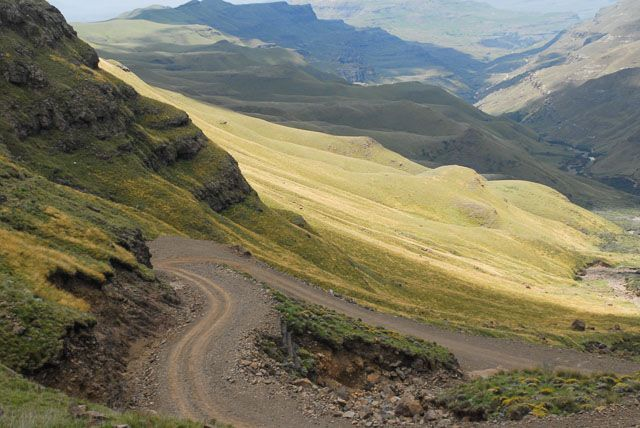 Winding gravel road through hills, Sani Pass, South Africa road trip - Top Tips for a South Africa Road Trip