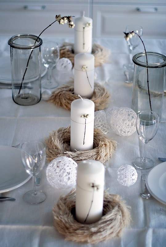 Tie sprig to pillar candles and set in a mini bird's nest.
