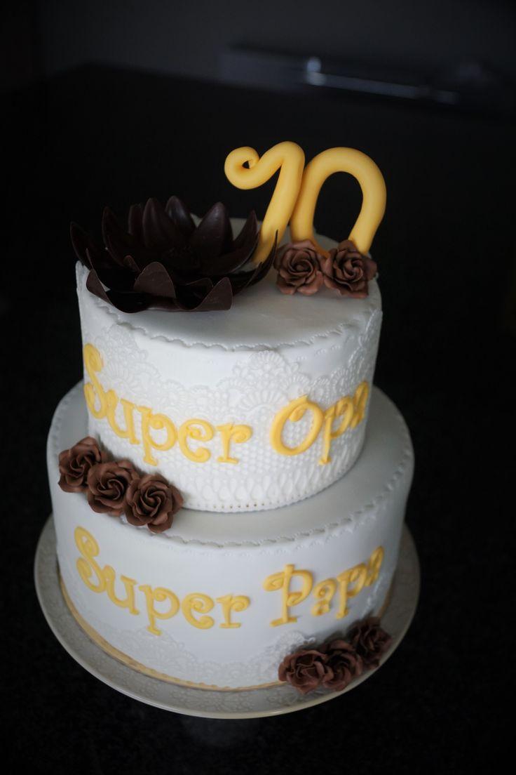 Thema: Papa/opa wordt 70 jr, na foto werd de 7 gecorrigeerd  Taart: Biscuit met limoencrème en biscuit met frambozenmousse  Versiering: chocoladebloemen