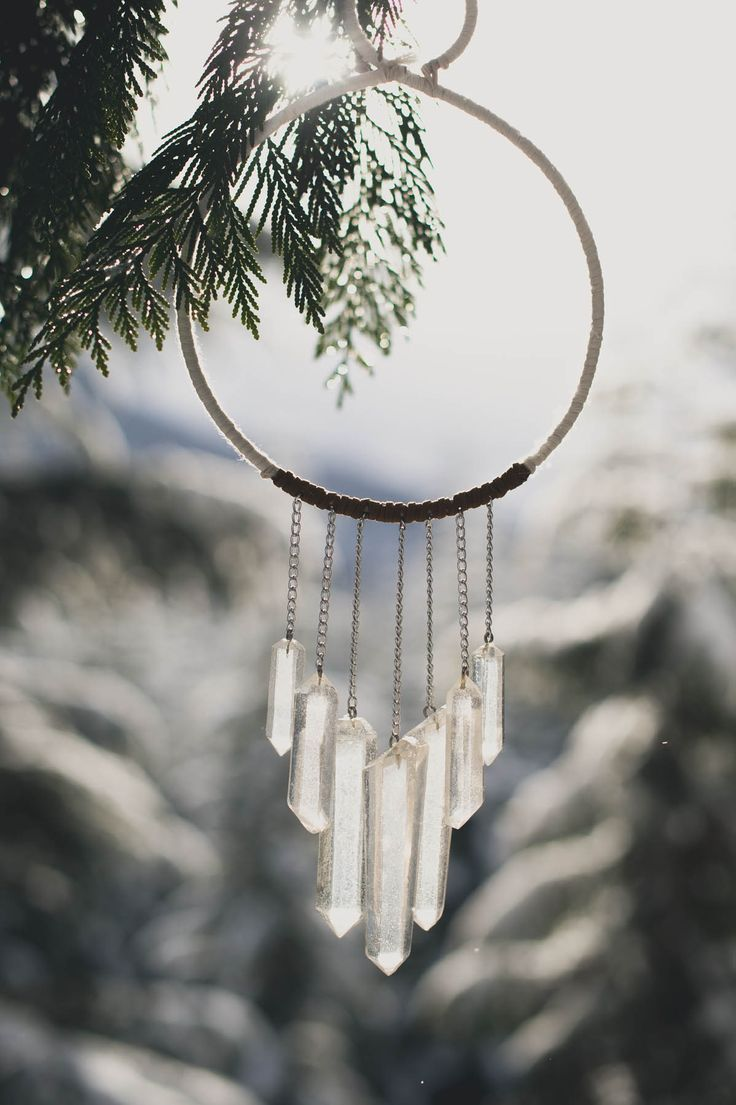 Quartz dream catcher. Snowy mountain elopement shoot by Spread Love Events, Rebecca Amber Photography, & Celsia Florist. Whistler, British Columbia.