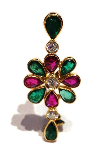 Flower of Rubys and Emeralds  This Brooch is realized with: Emeralds, Rubys, Diamonds brilliant cut and Yerllow Gold.  Emeralds 0,90 kt.  Rubys  0,60 kt.  Diamonds brilliant cut 0,21 kt.  F color  VVS 2  Yellow Gold 18 kt.  Total Weight 3,40 g.  1800$  Available only on Www.bangslove.com